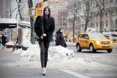 fur coat with leather trousers
