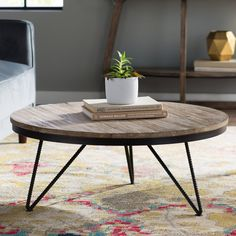 <p>Complete your ensemble in chic and trendsetting style with this must-have this Coffee Table. Showcasing a lovely reclaimed fir wood top, textured black iron base, distressed finish, and round shape, this lovely coffee table will be the stylish centerpiece for any arrangement. </p><p>Try setting this lovely coffee table in your living room for a hint of vintaged style. Then add a blue hydrangea bouquet, antiqued birdcage accent, light pink rug, and weathered white cha...