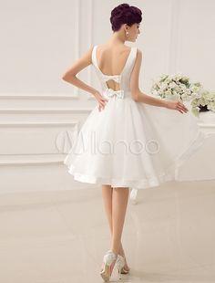 Vestido de novia con escote barco y rebete
