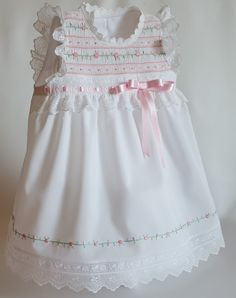 This beautiful Baby Girl Diaper Dress is perfect for welcoming house visits. The tri-dimensional flowers on the front center of - Salvabrani Smocked Baby Dresses, Little Girl Dresses, Girls Dresses, Girls Frock Design, Baby Dress Design, Sewing Patterns Girls, Dress Patterns, Smocks, Frocks For Girls