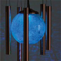 Color-Changing Wind Chime -This  solar wind chime illuminates at night, providing a glow that gradually transitions through a variety of seven  colors (one every three seconds): red...blue...green...and more. It uses stored-up energy from the sun. A built-in light sensor turns the crackled-glass globe on and off at dusk and dawn.