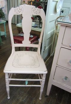 This oldie is a wonderful vintage chair with its original leather seat. We painted it our beautiful vintage pink and distressed it it in all the right places. We even applied the pink to the fabulously decorative leather seat. The top of the chair features gorgeous carved detail. What an absolute honey!    The best of all - there are two of these available! Please email if you would like to purchase both.