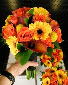 Floral design by, Graciel Evenstar orange roses, mini gerbs, mango callas, billy balls.
