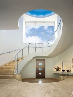 """The entrance hall """"is vertically enhanced by a blue vaulted dome that emulates the Florida sky,"""" he says Modern Architecture House, Modern Buildings, Architecture Details, Interior Architecture, Interior Design, Interior Modern, Architectural Digest, Modern Architectural Styles, Modern Hallway"""