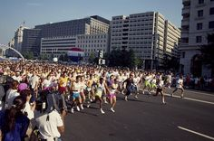 1990 - The race for the cure is what the picture shows. It was and still is a 5K race to raise money for Cancer. Runs like these have brought happiness to Americans for a while now, as foundations like the Susan G. Komen foundation greatly help the fight for Cancer research and a cure. Happiness Project, How To Raise Money, Picture Show, The Cure, Dolores Park, Foundation, Fashion Inspiration, Cancer, Bring It On