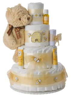 Gender neutral baby cake Winnie the Pooh 4 tier diaper cakes makes a great gender neutral baby gift. Winnie the Pooh is such a classic and lives beyond one generation of children. Idee Baby Shower, Baby Shower Diapers, Boy Shower, Baby Shower Cakes, Baby Shower Themes, Baby Shower Gifts, Baby Gifts, Baby Cakes, Shower Ideas