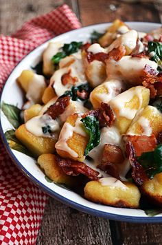 Roasted Garlic Gnocchi with Bacon, Spinach, and Smoked Gouda Cream Sauce. 2/9/16 - Really good - just a little time consuming and you should definitely be prepped first.