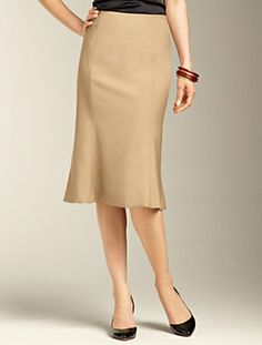 RECOMMEND: Tulip skirt. Hem must hit right at the knee. Because the bottom has a flourish, the top half must be simple, clean, and narrow. (Wrong color, A+ shape)