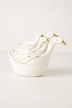 "SWAN MEASURING CUPS! gahh. Not necessarily ""swans"" but they're gold noses and wings with white bodies and long necks are swan enough for me :)"