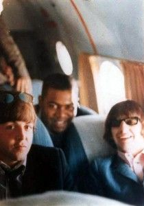 August 1965. Paul and Ringo pictured midflight, during their US tour, with support act King Curtis.