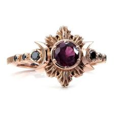 READY TO SHIP SIZE 6 - 8 Rhodolite Garnet Moon Fire Gothic Engagement Ring with Black Diamonds This is part of my Pyre Series inspired by fire and the rebirth that follows destruction. The center stone is a faceted Rhodolite Garnet it weighs approximately .50 carats and is 5mms