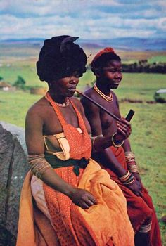 Africa | Xhosa woman smoking a pipe.  Transkei.  South Africa || Postcard image //