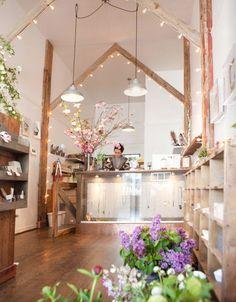 Beams w/ lights in flower shop. beautiful!!