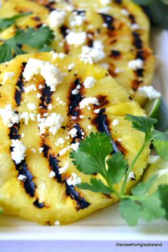 Grilled Pineapple Salad ---  Throw the pineapple on the grill as you're taking everything else off, and you'll have the perfect side dish for any barbecue!