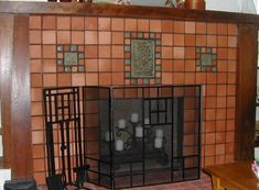 Fireplace, unglazed red terra cotta tile with green glazed scenic tile and 2 X 2..