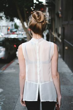 PERFECT: Buttons up back + tux. pleats on white silky blouse = classic + sophisticated, but it's sheerness and the length (plus the black bra underneath) make it instantly updated and sexy. High-ish bun = classic, but undone and loose = laid back, fresh, sexy.  minimal. but spot on.