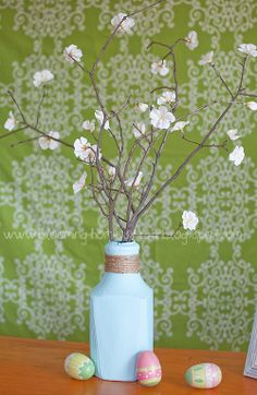 Spring Vase {DIY}: paint an OJ jug and hot glue silk blossoms onto some sticks. There you go!