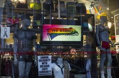 A screen with the words 'We Stand With Orlando' is displayed in a shop window in London's ...