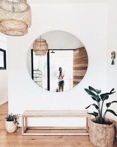 oversized round mirror in entry way