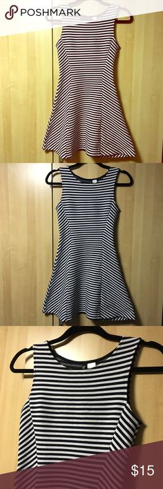 H&M Fit & Flare Dress A lovely fit & flare/skater style stripe dress from H&M. This looks like black and white stripes, but it's more of a really dark navy blue color and white. The material is more thick than a regular dress. More suitable for colder weather, great for work with a cardigan/blazer. Size is 4, but fits more like an xsmall than small. Worn a few times, still in good condition but there's some light fuzzing, last one is a zoomed in photo. Questions welcomed H&M Dresses