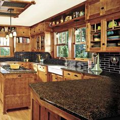 Countertop, and white farmhouse sink are lovely. But really they had me with the glass-front cabinets & fiestaware. Love.