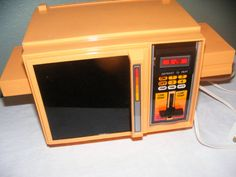 Vintage 1983 Easy Bake Oven-- I had this year make and model I can almost taste the burnt doughy chocolate cake!!! Memories