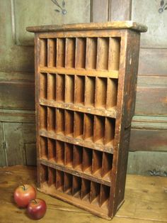 Old Slotted Cabinet ~ Hannah's House Antiques on Ruby Lane. $125