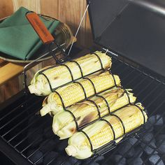 Improvements Non-Stick Adjustable Corn Grilling Basket ($12) ❤ liked on Polyvore featuring home, kitchen & dining, kitchen gadgets & tools, bbq, grill basket, grill accessories, grill, corn on the cob holder, corn on the cob and corn holder