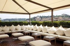 Roof Top Bar, Florence - simple wooden fabric shade supports.  Would have to design to wind load