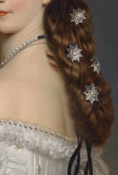A close-up of the diamond-set stars Empress Elisabeth of Austria wore in the hair she was justly famous for.  Winterhalter, 1865.
