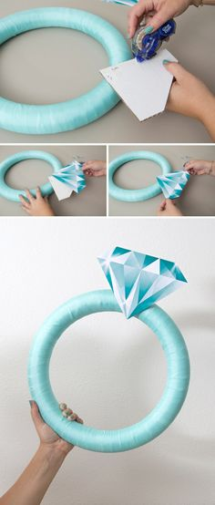 This Giant Diamond Ring Is The Perfect DIY Bridal Shower Door Decor! OMG, how cute is this giant DIY diamond ring wreath! The post This Giant Diamond Ring Is The Perfect DIY Bridal Shower Door Decor! appeared first on Do It Yourself Fashion. Bridal Shower Planning, Bridal Shower Party, Bridal Shower Decorations, Wedding Planning, Wedding Decorations, Diy Engagement Decorations, Wedding Showers, Tiffany Bridal Showers, Bridal Shower Crafts