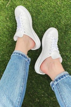 Slip on white adidas Stan Smith sneakers - perfect for your on-the-go summer.