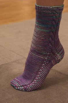 I'll Walk My Way socks  -- Very interesting use of cables to outline scok structure.  And it is a FREE Ravelry pattern.  Check out Ravelry detail page to see wide range of possible yarn styles.