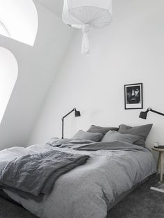 Modern Bedroom with beautiful clean textiles and paint.
