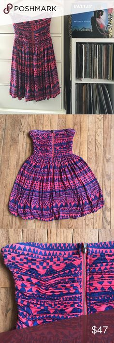 """🎉Anthropologie Tribal Tube Dress 🌺 Plenty by Tracey Reese  Sold at Anthropologie  Size small Measurements laying flat  Bust 11"""" Waist 12"""" Hip 21"""" (fabric extended) Length 25.5"""" Strapless  Exposed front zipper detail  Fitted bodice with gathered stitching  Internal shelf bra. Side boning  Aztec tribal print pink and navy  Excellent used condition 8.4/10 Anthropologie Dresses Strapless"""
