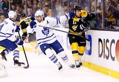 Toronto Maple Leafs at Boston Bruins Game L 4-1- 05/01/2013 Clarke MacArthur #16 of the Toronto Maple Leafs and Gregory Campbell #11 of the Boston Bruins collide behind the goal in the first period in Game One of the Eastern Conference Quarterfinals during the 2013 NHL Stanley Cup Playoffs at TD Garden in Boston, Massachusetts.  (Photo by Jared Wickerham/Getty Images)