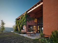 A contemporary interpretation of the traditional 'cascina' and barns typical of the Piacentine countryside in Italy. Park Associati