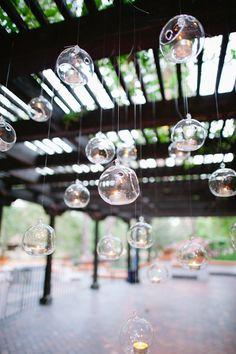 love these hanging votives  http://www.wholesaleflowersandsupplies.com/hanging-glass_globe_vase.html