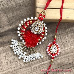 Amazing dazzle gota base kundan work red-white Beautiful red love flower made this Rakhi more attractive & this tubelight accessories with white beaded dangler it is looking so lovable you can't find anywhere else. Shop Now! Henna Art Designs, Wedding Mehndi Designs, Buy Rakhi Online, Handmade Rakhi Designs, Rakhi Making, Diy Diwali Decorations, Jar Chandelier, Sewing Baby Clothes, Hot Pink Flowers