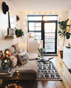Lovely living room. Particularly love the fairy lights and the Good Vibes cushion