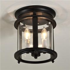 """Classic Ceiling Lantern - Large Classic Ceiling Lantern: Oil rubbed bronze with clear curved glass. 3x60 watts. (candle base socket) (12.5""""H x10.5""""W).  $215"""