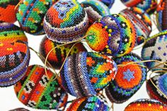 These beautiful beaded eggs were made by pressing tiny glass beads into natural beeswax spread over a paper-mache form.  Bead art is made in limited quantities by the Huichol and Tepehuano Indians of southwestern Mexico.