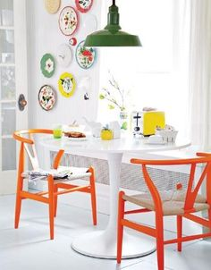 Ikea Docksta table and bright chairs.  with this look, you want your light fixture to be a bit whimsical or funky or industrial.