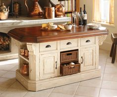 Definitely need to make our kitchen counters from wood - maybe wormy chestnut to match cabinets Daddy made