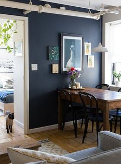 Sherwin Williams Naval, a navy blue paint colour has a low LRV and will look dark in a room without enough artificial or natural lighting