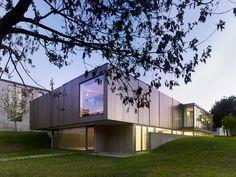 Exhibition Hall in Bertamiráns is a minimalist building located in Galicia, Spain, designed by Salgado Liñares Arquitectos.
