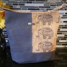 Gorgeous Bonnie bucket bag in stunning charcoal and elephant print cork leather. Zippered top with interior zippered pocket. Beautiful metal nickel accents and hardware available in the shop. Pattern by Swoon bag sewn by @bewitchingstitchery
