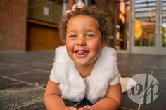 Sweet photos of a silly little girl. Taken in downtown Fayetteville, Arkansas by Whitney Flora Photography.