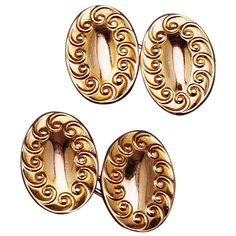 Gold Art Nouveau Cufflinks. These double-sided links are bordered by raised scrolls enclosing a slightly domed center in 14k gold. The backs are connected by oblong gold chain links for easy wear and security.  Circa 1920