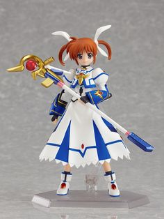 """This cute figma is the heroine of the *Magical Girl Lyrical Nanoha* franchise, Nanoha herself! Wearing her iconic barrier jacket, Nanoha comes with her characteristic weapon """"Raising Heart"""" in both Accel Mode and Buster Cannon Mode as well as two interchangeable expressions: her normal bright smiling face, and a shouting expression too so you can display her in the full heat of battle. With the fa..."""